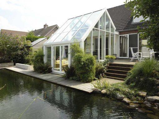 Renovatie, aluminium serre en openslaande tuindeuren in Helden